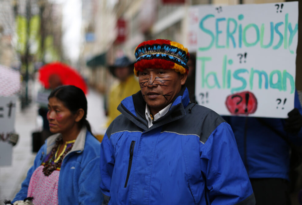 Achuar Leaders from Peru protest outside Talisman Energy's annual general meeting in Calgary