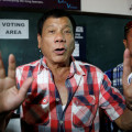 "Presidential candidate Rodrigo ""Digong"" Duterte talks to the media before casting his vote at a polling precinct for national elections at Daniel Aguinaldo National High School in Davao"
