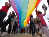 epa06352241 Participants of the Lesbian, Gay, Bisexual and Transgender initiative (LGBT) walk in a pride march in Bangalore, India, 26 November 2017. Hundreds of members of sexual minorities and their supporters waved flags, beat drums and danced to local tunes as they took out the Bengaluru Namma Pride March on the busiest streets in the city and called to end violence and oppression based on gender identity and sexual orientation and to end gender decriminalization.  EPA/JAG NV